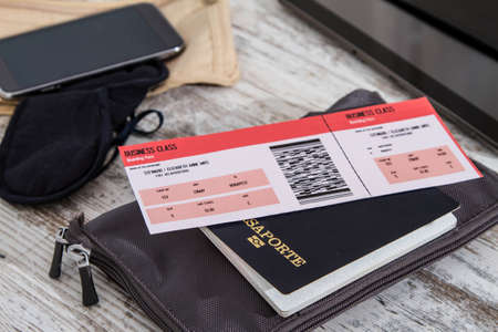 Airline ticket, passport and electronics, preparing to travel  photo