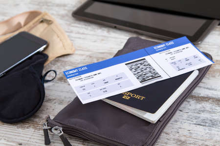 Airline ticket, passport and electronics, preparing to travel