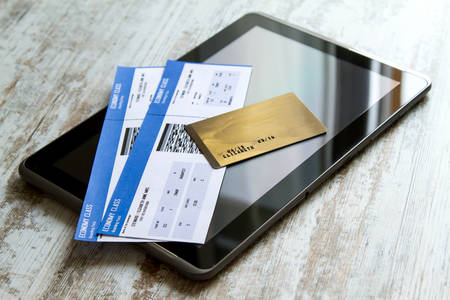 Buying airline tickets on line with a credit card Foto de archivo