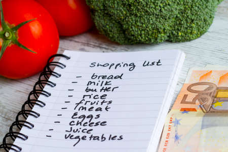 Preparing the shopping list before going to buy the groceries. Stock Photo