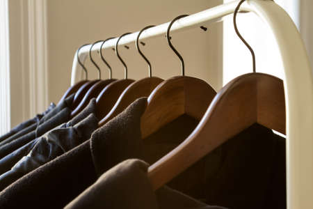 Winter clothes hanged on a clothes rack photo