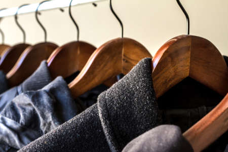 clothing store: Winter clothes hanged on a clothes rack Stock Photo