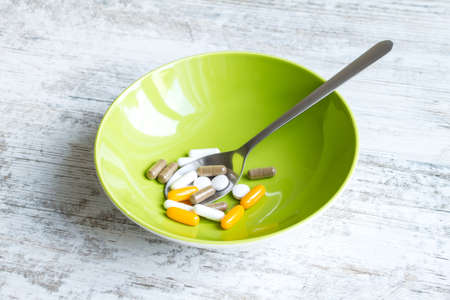 cure prevention: Vitamins and dietary supplements Stock Photo