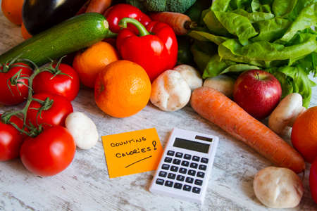 Counting calories, diet of  vegetables and fruits Banco de Imagens