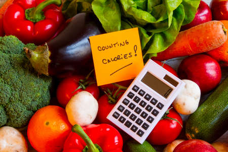 Counting calories, diet of  vegetables and fruits background Foto de archivo