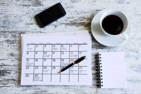 calendar: Checking monthly activities and appointments at the office