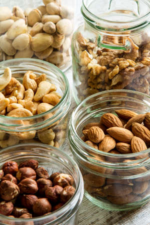 mixed nuts: Selection of dried fruits in jars Stock Photo
