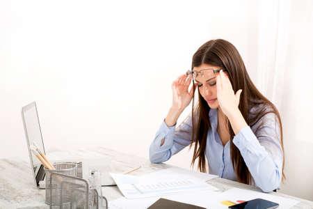 Having a headache after working really hard Foto de archivo