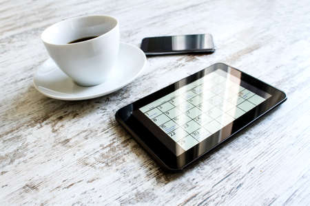 appointments: Checking monthly activities and appointments at the office in the tablet