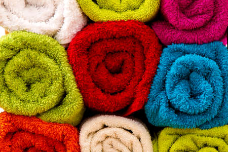 terry: Group of colorful towels rolled up, background