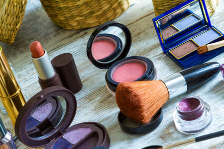 make up products: Putting on make up before going out