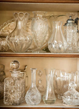 antique vase: Antique glass vase on a china cabinet Stock Photo