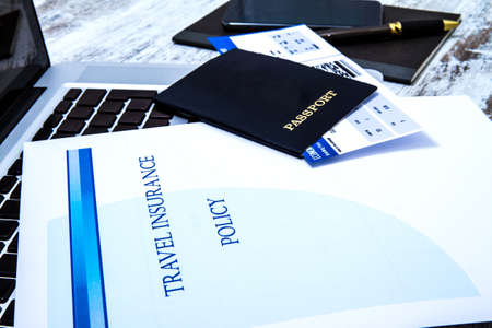 boarding: Travel insurance policy booklet with a boarding pass and a passport