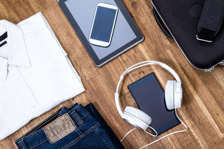 informal: Informal male outfit with electronics, background Stock Photo