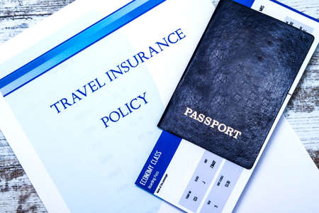 passes: Travel insurance policy booklet with a boarding pass and a passport