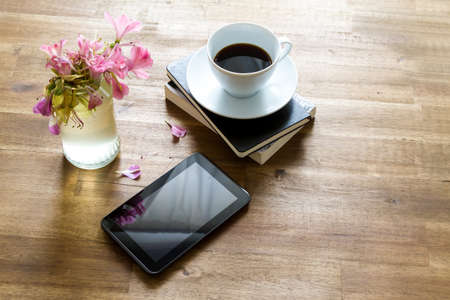 Reading books and with the tablet and drinking coffee on a relaxed afternoon. Stock Photo - 42022086