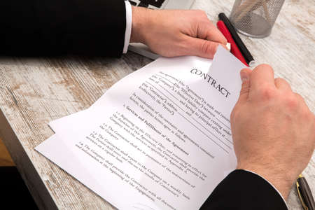 A businessman reading a Contract before signing