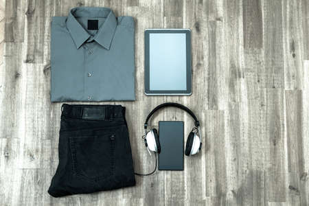 informal clothing: Informal male outfit with electronics, background Stock Photo