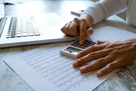 financial audit: Analyzing numbers and doing calculations at the office