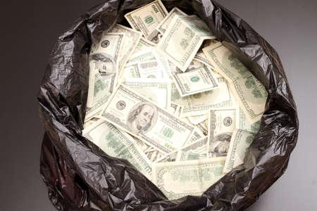 A Rubbish bag full of dollars