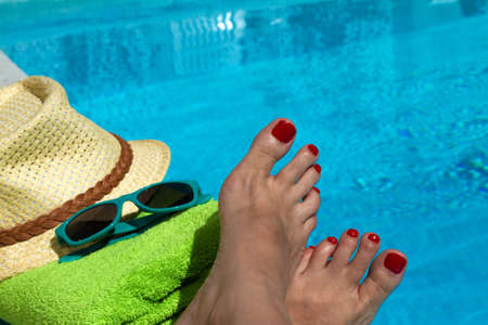 vacation destinations: Refreshing the feet in the swimming pool