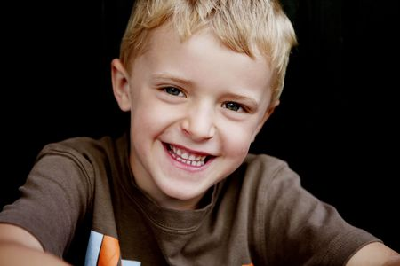 Close-up of a smiliing blond boy looking at camera Stock Photo - 6521332