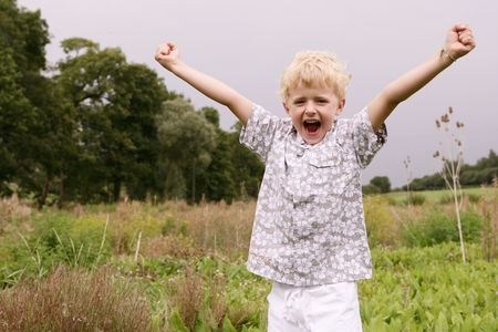 Close-up of a small blond cute boy screaming with arms outstreched Stock Photo - 6521378