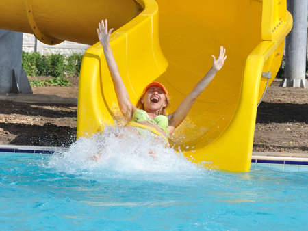 The girl on a waterslide in an aquapark