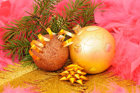 Christmas tree decorations on gold fern branch and pink swans down photo