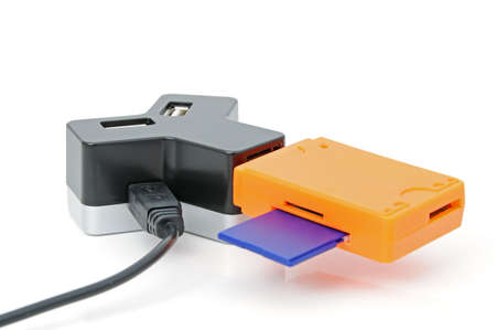 cardreader: USB-HUB for four inputs and Card-reader with SD-card Stock Photo