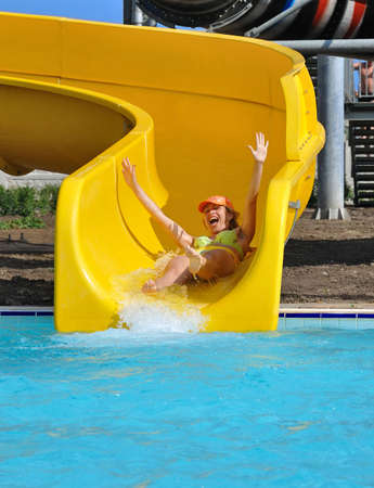 Girl on a waterslide in the aquapark