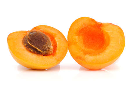 Ripe apricot with a pit on a white background Stock Photo
