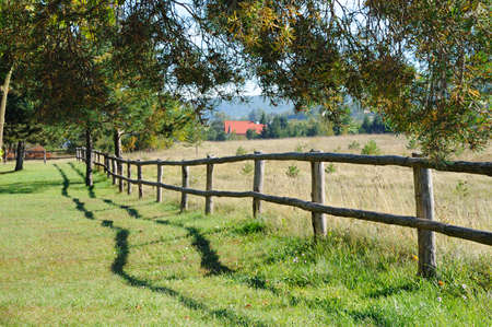 Wooden fence in a village Stock Photo - 8691780