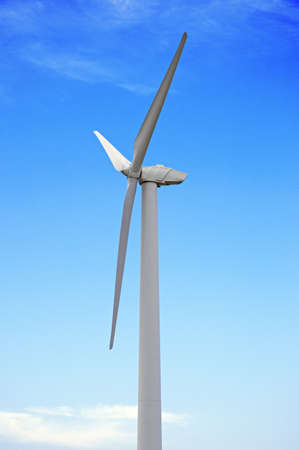 conservational: Wind-powered generator against the blue sky