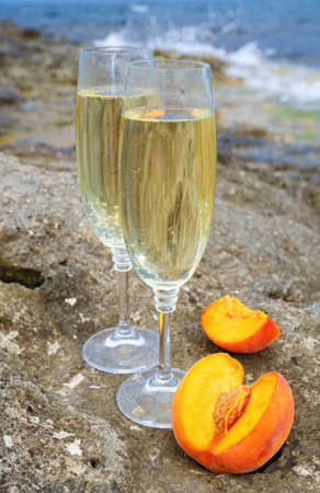 Glasses with champagne against the sea photo