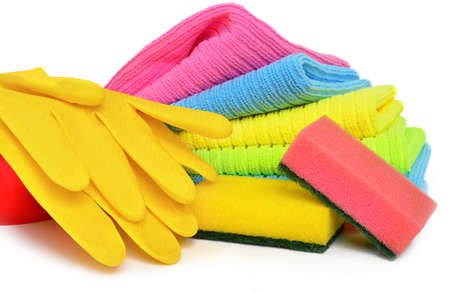 Sponges, towels and rubber gloves on the white background Stock Photo