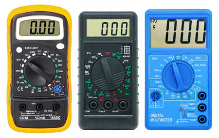 Multimeters for measurement of voltage, a current, resistance. Isolated on a white background. photo