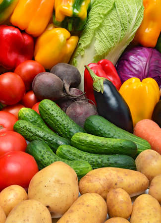 Crop of vegetables. Tomatoes, peppers, eggplant, cucumbers and other vegetables. Stock Photo