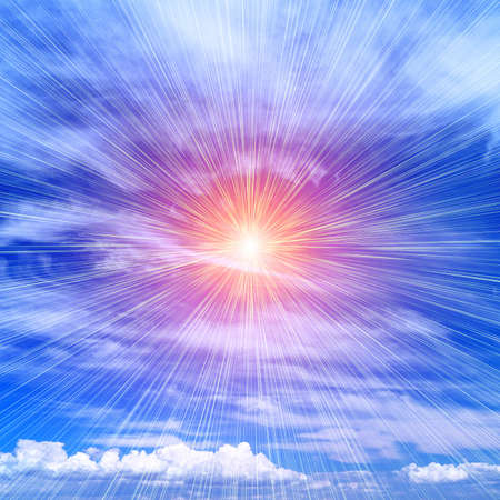 Bright rays of the sun against a blue cloudy sky photo