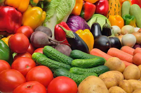 Crop of vegetables. Potatoes, peppers, tomatoes, cucumber, eggplant and other vegetables. Stock Photo