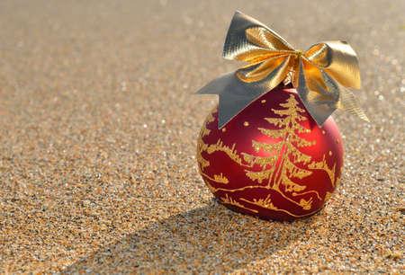 Christmas decoration against beach sand  photo