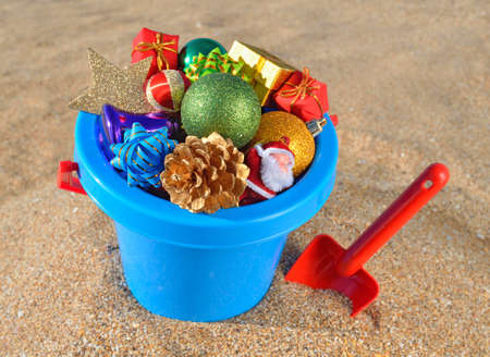 Christmas decorations and children's toys on the beach sand photo
