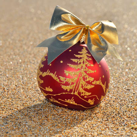 Christmas decoration on yellow sand  photo