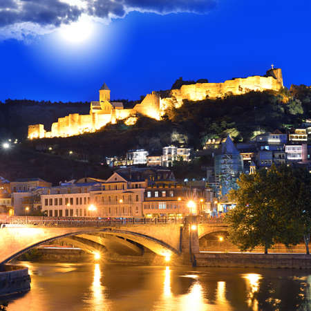 Tbilisi Old Town, Historic district of the capital of Georgia at night against the dark blue sky