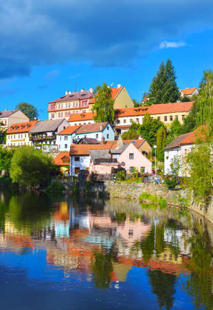 Czech Krumlov. South Bohemian Region of the Czech Republic. Colourful reflections of old houses in the Vltava River. Cesky Crumlaw on the Vltava River photo