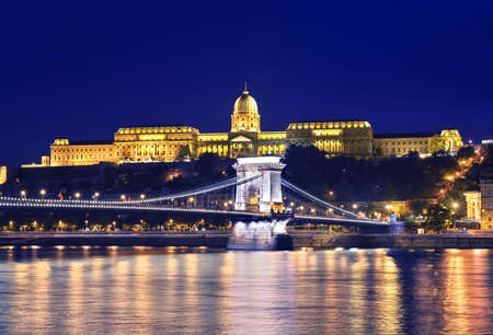buda: Danube river, Chain Bridge and Buda Castle (Royal Palace) at night in Budapest, Hungary.