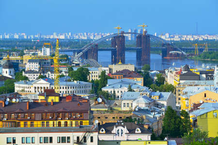 dnieper: View of the city Kiev and the Dnieper River with a new bridge. Capital of Ukraine - Kyiv.