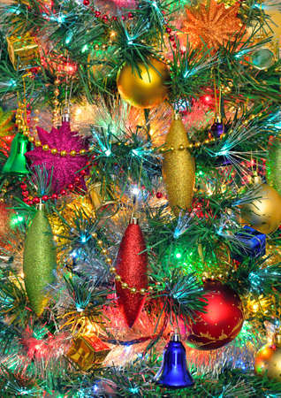 Christmas tree with Christmas decorations and festive illuminations photo