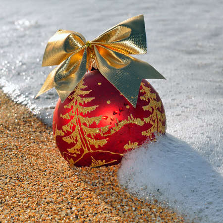 Christmas decoration on the beach against ocean wave