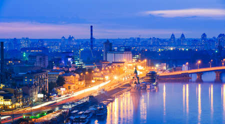 Kiev city, Capital of Ukraine. View of the Dnieper river, Havana bridges and Naberezhno-Kreschatitska street. Night panorama of Kyiv.